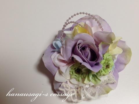 明るい色のコサージュ(ライトパープルローズと紫陽花)